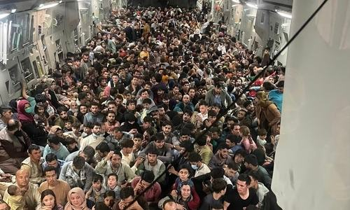 Over 600 fleeing Afghans cram into dramatic US military flight