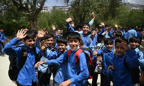 In pictures: Some Afghan students return to schools in Kabul but most stay away