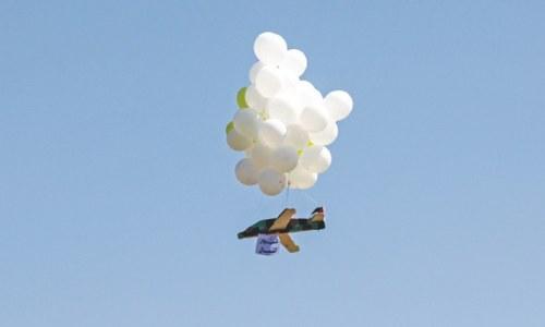 Hamas operatives launch incendiary balloons into Israel