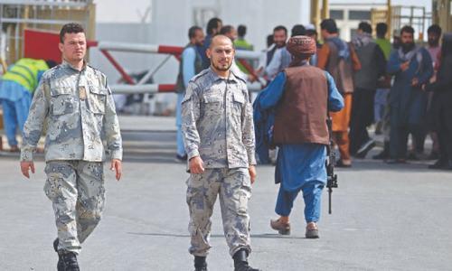 Afghan police return to work alongside Taliban at airport