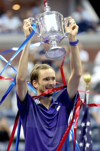 Daniil Medvedev of Russia celebrates with the championship trophy after defeating Novak Djokovic of Serbia to win the Men's Singles final match of the 2021 US Open at the USTA Billie Jean King National Tennis Centre in New York City. — AFP .