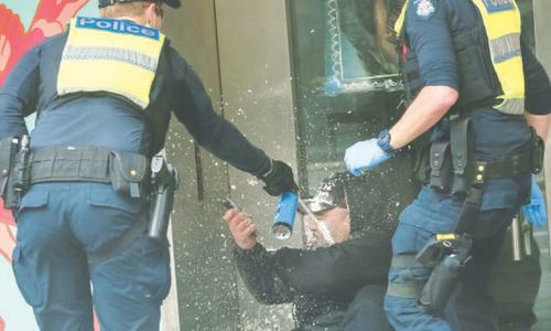 Violent protests against Covid curbs continue in Australian city