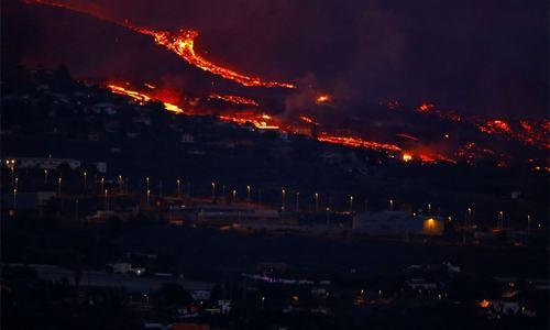 Volcano razes hundreds of buildings on Spain's island