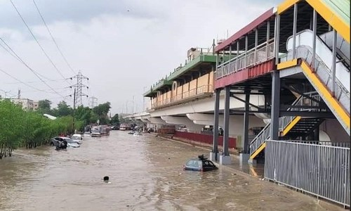 Flooded roads and traffic jams as torrential rain hits parts of Karachi
