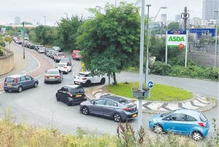 Long queues, fuel rationing as Britain faces truck driver shortage