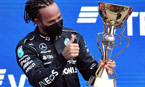 Hamilton reclaims top spot with historic 100th F1 triumph
