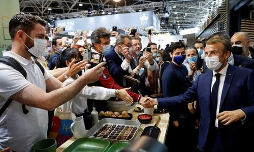 Macron hit with egg during visit to trade fair