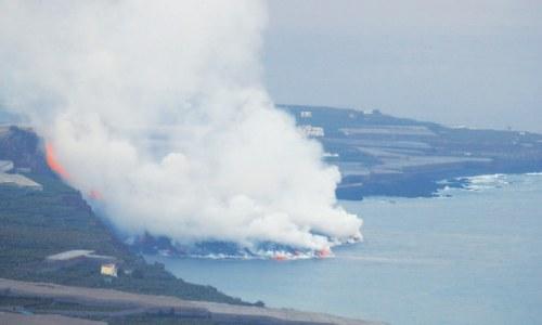 Canaries volcano lava reaches sea, raises toxic gas fears