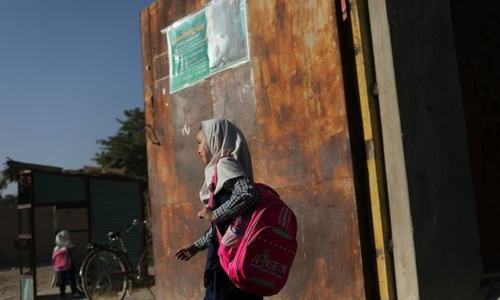 Afghan girls stuck at home, waiting for Taliban plan to re-open schools