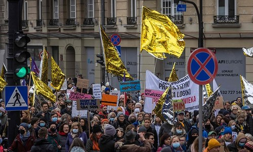 Thousands of Poles rally in support of migrants