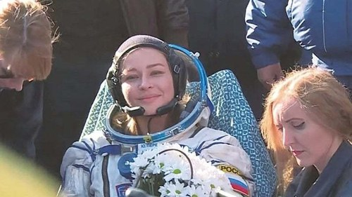 Russians return after filming  first movie in space