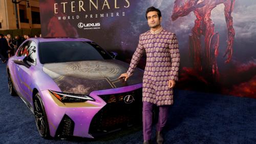 Kumail Nanjiani brings his sartorial A game to the Eternals LA premiere in a purple Umar Sayeed sherwani
