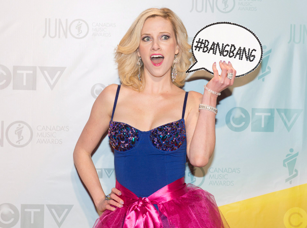 'World sexiest comedian' Nicole Arbour poses for photographs on the red carpet. —Photo by AP