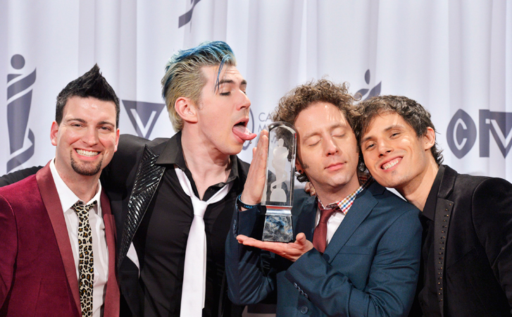 Marianas Trench pose with the Juno after winning group of the year. —Photo by AP