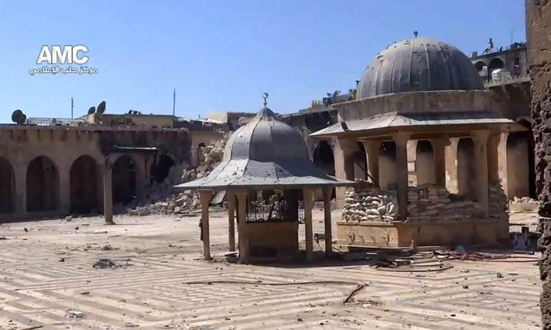 An image grab taken from a video uploaded on YouTube on April 24, 2013, allegedly shows the rubble of the minaret (background) of Aleppo's ancient Umayyad mosque. -AFP Photo