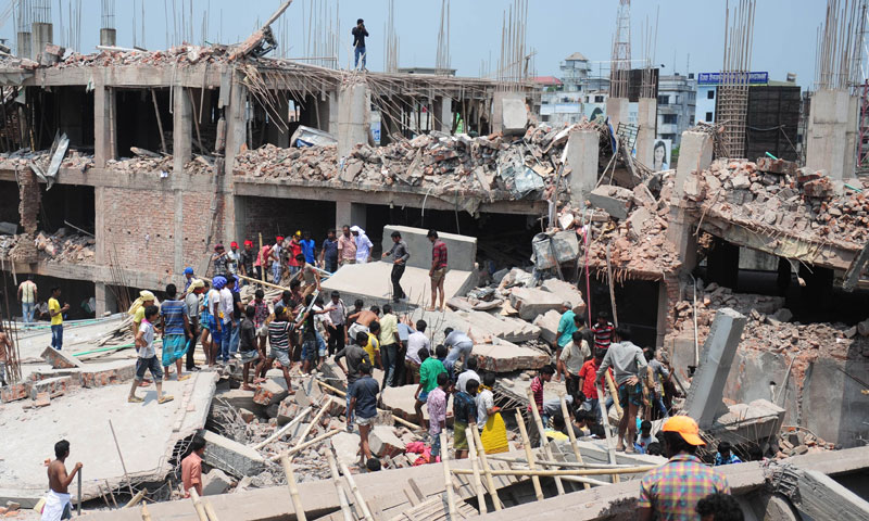 Bangladeshi civiliant volunteers assist in rescue operations after an eight-storey building collapsed in Savar, on the outskirts of Dhaka, on April 24, 2013. — Photo AFP
