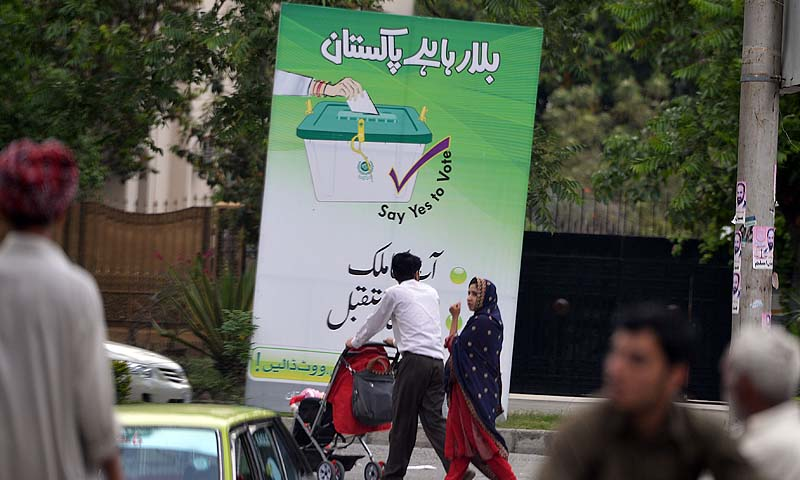"A Pakistani couple walk past an electoral billboard with the message ""Pakistan is calling, your country your future,"" in Islamabad, on April 24, 2013. Next month's elections should mark the first democratic transition of power in Pakistan, but Taliban threats, social taboos and poor organisation will deprive millions of women their right to vote.There are more than 85 million registered voters for May 11 -- 37 million women and 48 million men -- in a country ruled by generals for half its life and where military co"