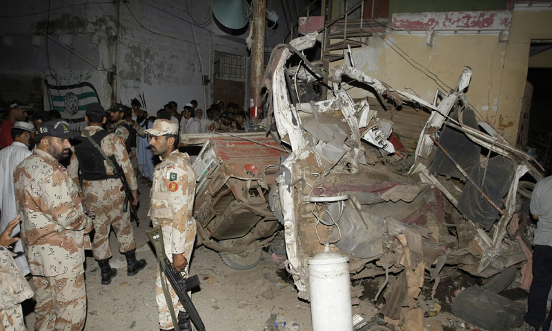 Pakistani para-military troops cordon off the site of an explosion in Karachi, Pakistan Friday, April 26, 2013.  — Photo by AP
