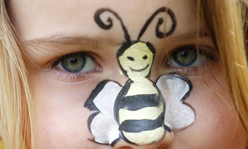 Amber, 5, sports a bee painted on her nose as she joins her mother at a protest in Parliament Square to urge Britain's government to ban the use of pesticides containing neonicotinoids, in central London. EU governments failed last month to agree a ban on three widely used pesticides linked to the decline of honeybees, but the European Commission is threatening to force such a ban through unless member states agree a compromise.—Photo by Reuters