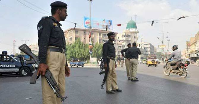 Policemen stand alert in Karachi. — File Photo