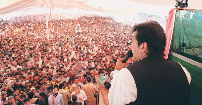PTI Chief Imran Khan addressing an election rally here on Thursday. — Photo by Dawn