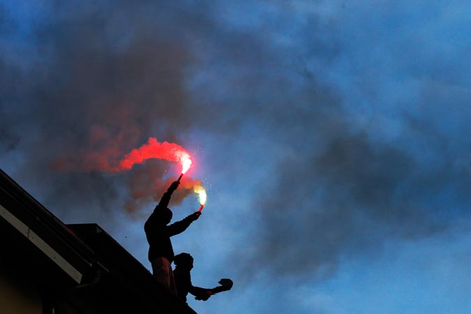 Left wing demonstrators light fire works to support the annual left wing demonstration on May Day in Berlin. —AP Photo