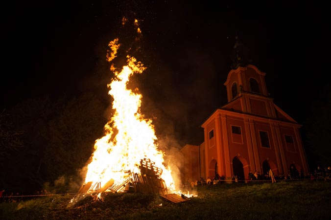 People stand near a bonfire during the Labour Day celebrations in Ljubljana. —AFP Photo