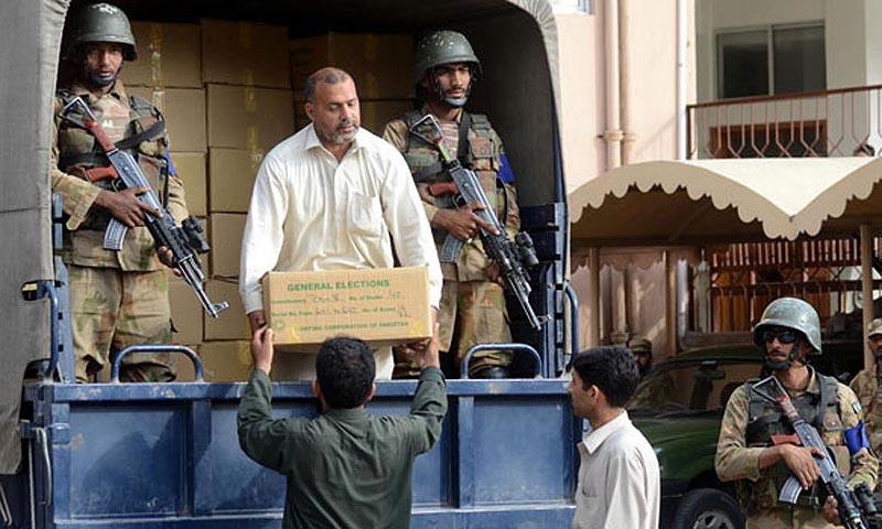 General Elections related material being handing over to concerned authorities at Judicial Comlpex under the supervision of Pakistan Army. — INP Photo by Hussain Ali
