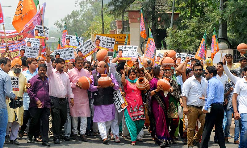 Activists of the main opposition Bhartiya Janata Party (BJP) carry earthen pots as they shout anti-Delhi Congress government slogans during a protest over the shortage of water in the Indian capital and surrounding residential areas, in front of the Secretariat in New Delhi. There has been a severe scarcity of water along with occasional power cuts in Delhi since the beginning of the summer.—Photo by AFP