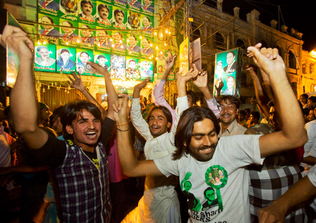 Supporters of PML-N party celebrate the primary unofficial results of the country's parliamentary elections at a party office in Lahore, Pakistan. The party, led by two-time Prime Minister Nawaz Sharif, has long been considered the front-runner in the race and it appeared to be moving toward a significant victory Saturday based on partial vote counts announced by Pakistan state TV. —AP Photo