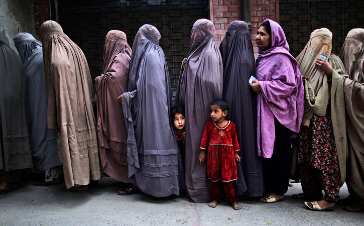 Pakistani women line up to enter a polling station, on the outskirts of Islamabad, Pakistan. —AP Photo