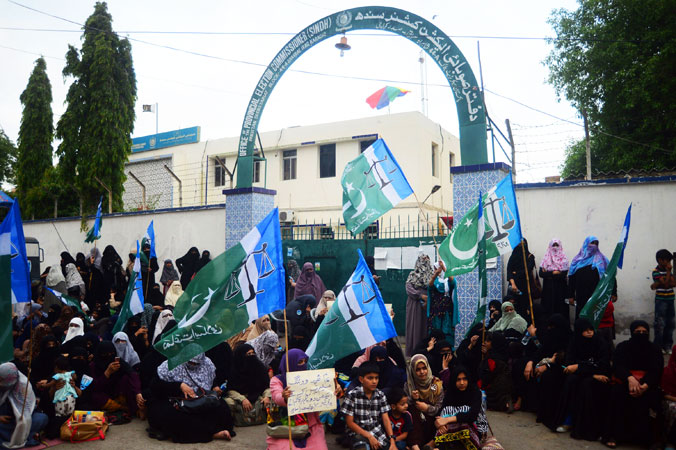Pakistani supporters of Islamic party Jammat-e-Islami (JI) stage a protest in front of a provincial election commission office in Karachi. —AFP Photo