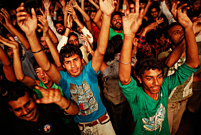 Supporters of the Pakistan Muslim League - Nawaz (PML-N) celebrate in front of a party office as results of the general election come in, in Lahore May 11, 2013. — Reuters Photo