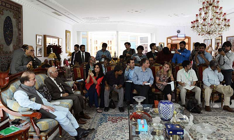 Pakistan's incoming prime minister Nawaz Sharif (2L) meets with journalists at his farm house in Raiwind on the outskirts of Lahore on May 13, 2013. — Photo by AFP