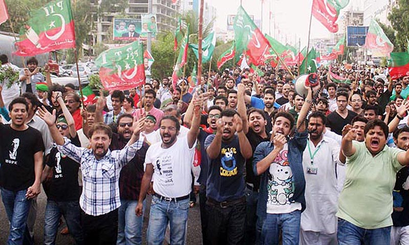 Activists of PTI march during a protest rally against alleged rigging at NA-250.— Photo by ONLINE