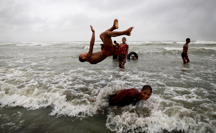 Novice Buddhist monks play in the shallow sea in Sittwe, northwestern Rakhine State, Myanmar, ahead of the arrival of Cyclone Mahasen. —AP PhotoThandawli villagers listen as they are briefed by UN and government officials about cyclone Mahasen at a Rohingya internally displaced persons (IDP) camp outside of Sittwe. —Reuters Photo