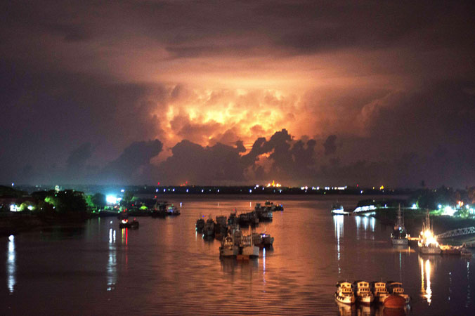 A storm lights up the sky above the Yangon river. Myanmar on May 12 began moving people into emergency shelters as a cyclone threatened to batter a violence-wracked region which is home to tens of thousands of internal refugees. —AFP Photo