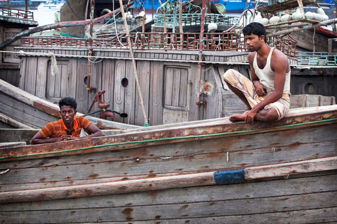 Bangladeshi fishermen sit on their boat on the banks of the river Kornofuli, in Chittagong, Bangladesh. Cyclone Mahasen is expected to make landfall early Friday. The storm was heading toward Chittagong, Bangladesh, but could shift east and deliver a more direct hit on Rakhine state in Myanmar. —AP Photo
