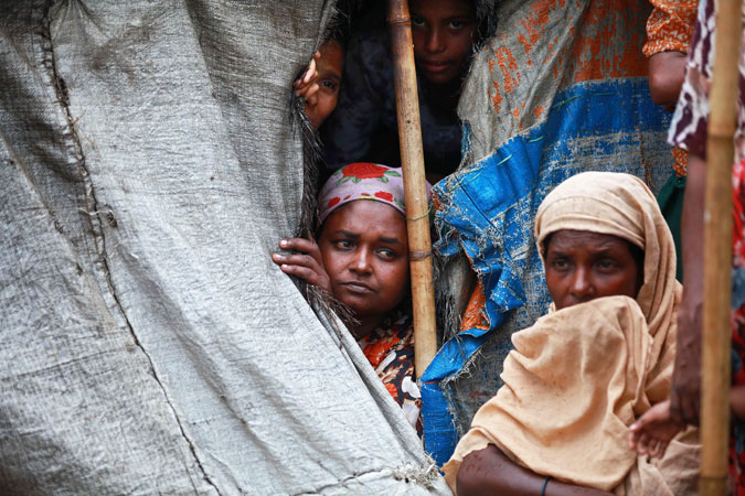 Muslim Rohingya women sit inside a tent at Mansi Internally Displaced Persons (IDP) camp in Sittwe. Boats carrying scores of Rohingya Muslims fleeing a cyclone have capsized off Myanmar's coast, the UN said on May 14, heightening fears over the storm which threatens camps for tens of thousands of displaced people. —AFP Photo