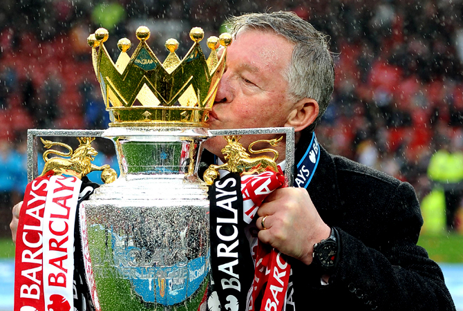 Manchester United's Scottish manager Alex Ferguson kisses the Premier League trophy at the end of the English Premier League football match between Manchester United and Swansea City at Old Trafford in Manchester, northwest England, on May 12, 2013. Ferguson said farewell to Old Trafford with a typically passionate speech after his side's 2-1 victory over Swansea in his final home match in charge of the team. — AFP Photo