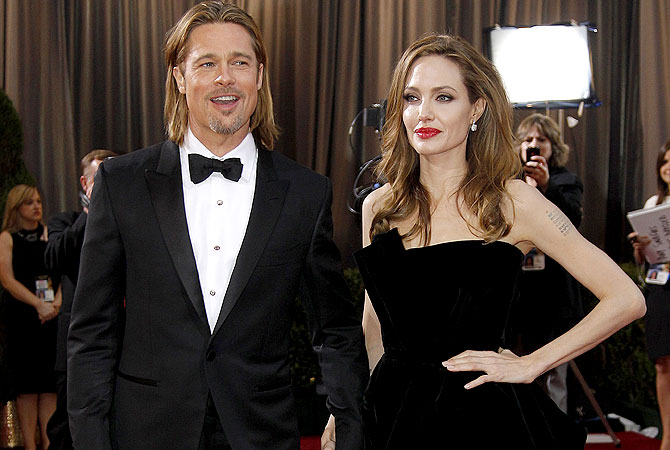 Angelina Jolie, right, and actor Brad Pitt at the 84th Academy Awards in the Hollywood section of Los Angeles.–AP (file) Photo