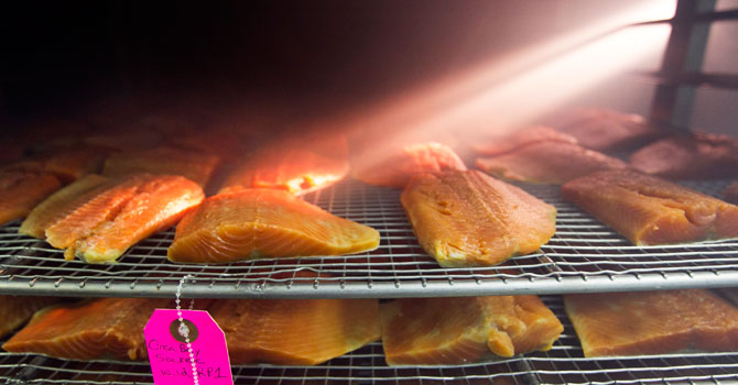 Wild sockeye salmon is smoked at the Ducktrap River company, in Belfast, Maine. —AP Photo