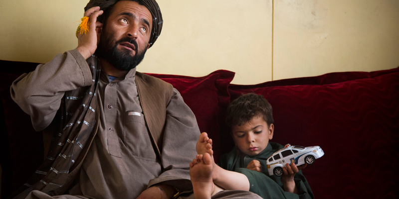 Mohammed Wazir sits with his only surviving son, Habib Shahin, 3, in Kandahar, Afghanistan on Monday, April 22, 2013 as he talks about the events of March 11, 2012 when a U.S. soldier burst into his family's home. Wazir returned to his home that morning to find 11 members of his family dead, their bodies partially burned. The youngest among the dead was his 1-year-old daughter Palawan Shah. — AP Photo.