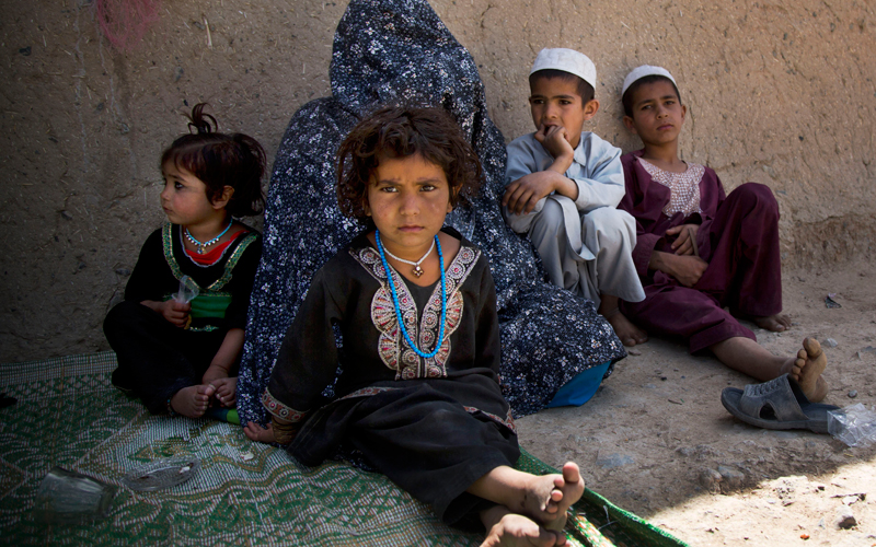 Masooma sits with her children at her brother-in-law's house on the outskirts of Kandahar, Afghanistan on Saturday, April 20, 2013. In an interview, Masooma recounted the events of pre-dawn March 11, 2012 when she says a U.S. soldier rampaged through two villages killing 16 people, including her husband.  — AP Photo.