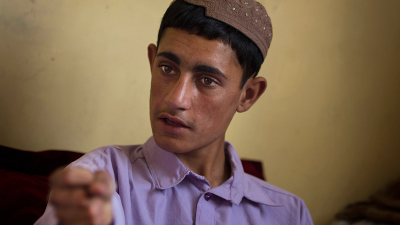 """Rafiullah, 16, talks in Kandahar, Afghanistan on Sunday, April 21, 2013 about a pre-dawn attack in southern Afghanistan last year, when he says a U.S. soldier burst into his family's house. Rafiullah remembers the soldier smashing through the door waving his pistol. Awakened in a room with his grandmother and his sister, Zardana, Rafiullah said they didn't know what to do. """"We just ran and he ran after us.""""  — AP Photo."""