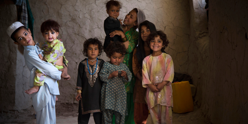 Masooma's son, Naseebullah, left, plays with his siblings and cousins at their home in the outskirts of Kandahar, Afghanistan on Saturday, April 20, 2013. In an interview, his mother recounted the events of pre-dawn March 11, 2012 when she says a U.S. soldier rampaged through two villages killing 16 people, including her husband.  — AP Photo.