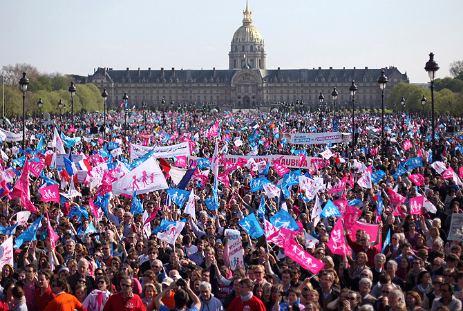 This April 21, 2013 file image shows demonstrators gathered at the Invalides square in Paris, during a rally to protest against French President Francois Hollande's social reform on gay marriage and adoption. — AP Photo