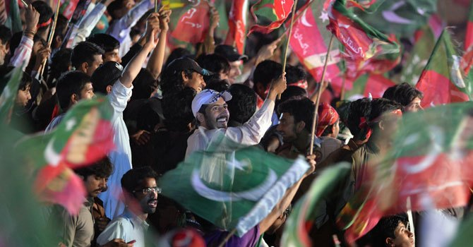 The image shows PTI supporters at a party rally. — Photo by AFP
