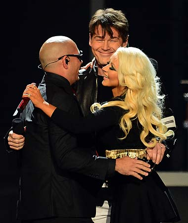 Pitbull, Morten Harket of A-ha and Christina Aguilera perform onstage during the 2013 Billboard Music Awards at the MGM Grand Garden Arena in Las Vegas, Nevada.—Photo by AFP