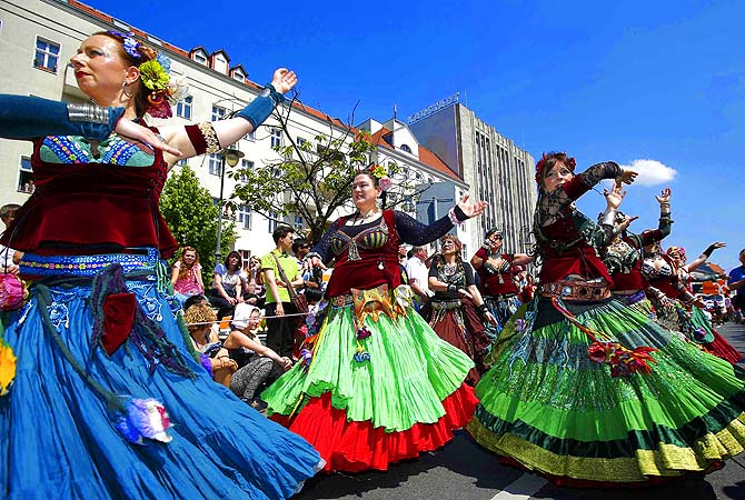 Revellers perform during the Karneval der Kulturen (Carnival of Cultures), a street parade of Berlin's ethnic minorities, in Berlin.—Photo by Reuters